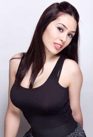 Sexy young beautiful woman posing in studio