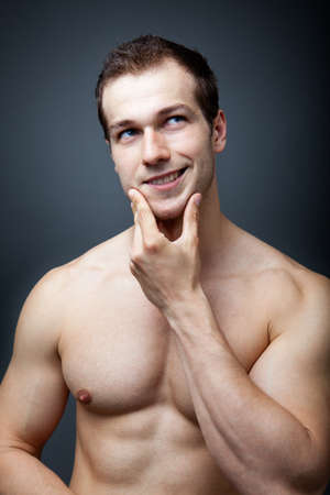 Muscles or brain concept - muscular man thinking Stock Photo - 12552692