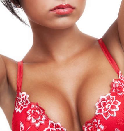 Woman with hot sexy breasts in red lingerie Stock Photo