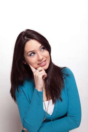 Creative pensive young woman over white Foto de archivo