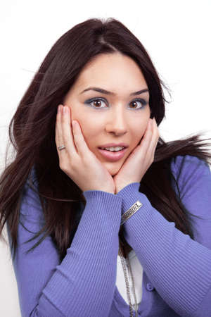 astonished: Surprise and shock expression on cute woman face Stock Photo