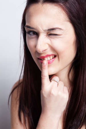 Teeth problems concept - woman touching her mouth
