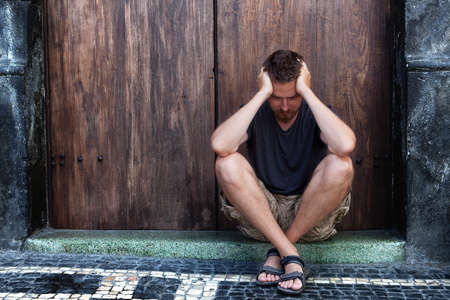 depressed man: Depression concept - sad and poor man on the street Stock Photo