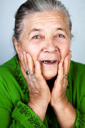 Happy and amazed old senior lady photo