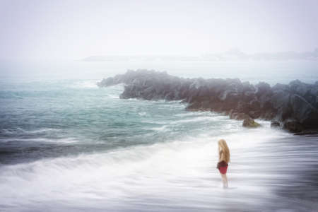 Depression and sadness concept - lonely woman and foggy sea Stock Photo - 13441828