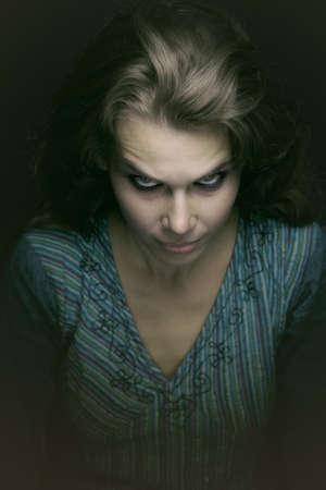 diabolic: Scary spooky evil woman in the dark
