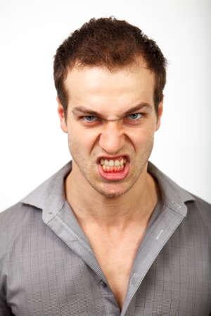 persona enojada: Hombre enojado molesto con la cara del mal miedo Foto de archivo