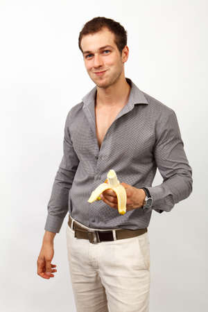 healthy nutrition: Healthy nutrition - young man eating a banana
