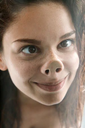 nose close up: Funny face of playful young woman Stock Photo