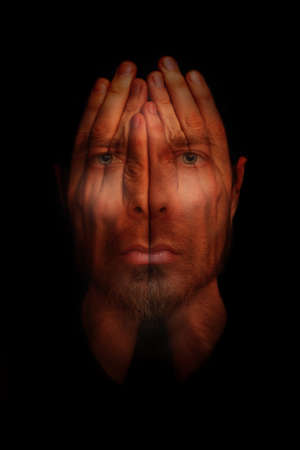 worries: Insomnia conceptual image - sleepless man with hands over open eyes
