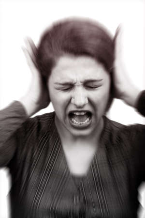 stress woman: Noise stress concept - stressed woman covering ears