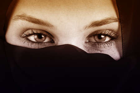 burqa: Eyes of arab woman with veil over face
