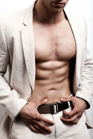 beautiful men: Man with sexy abs and elegant suit Stock Photo