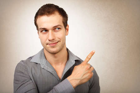 right on: Happy young isolated man pointing finger