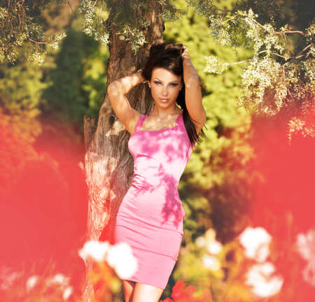Sexy attractive young woman posing fashion outdoors photo