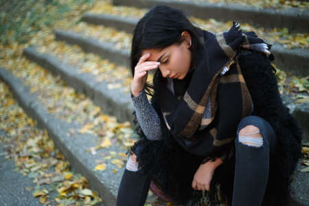 depressed: Depressed young unhappy woman outdoors