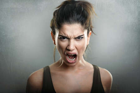 Caucasian woman: Scream of angry upset young woman