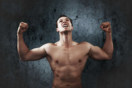 male athlete: Win scream of muscular strong male athlete