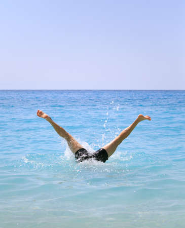 scubadiving: Funny summer holiday concept - legs of man swimming