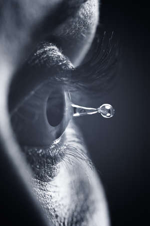 Macro on eye with tears water droplet photo