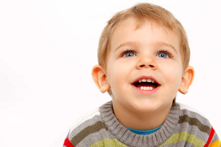 baby isolated: Face of happy kid in winter clothes looking up