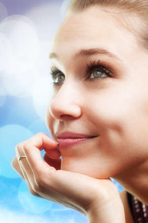 Bright portrait of pensive happy beautiful young woman photo