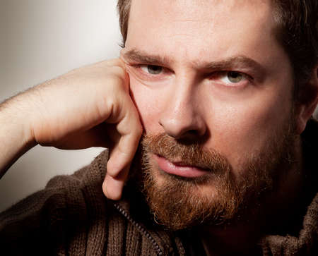 man face close up: Portrait of handsome calm bearded young man Stock Photo