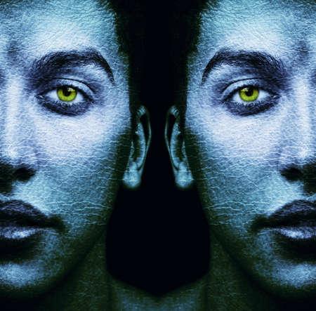 Textured faces of surreal male twins over black Foto de archivo