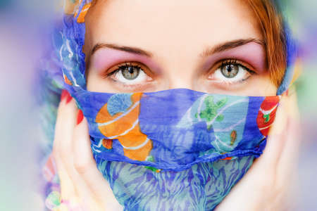 Vibrant portrait of woman with beautiful eyes and scarf photo