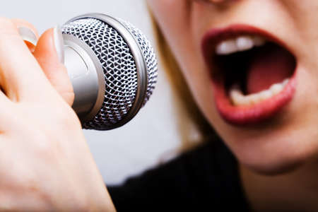 Close up on female singer mouth and microphone photo
