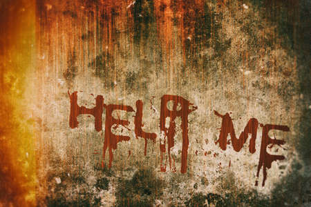 murdering: Horror Crime Concept. Help Message on Bloody Background Scary Wall Stock Photo
