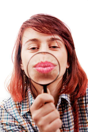 kissing mouth: Kiss of funny girl and magnifying glass Stock Photo