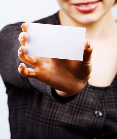 Female holding blank business card photo