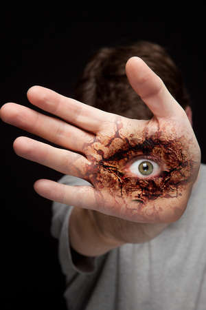hypnotize: Eye on human hand - vision and identity concept Stock Photo