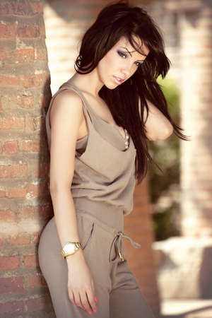 Fashion outdoor portrait of beautiful sexy young elegant woman photo