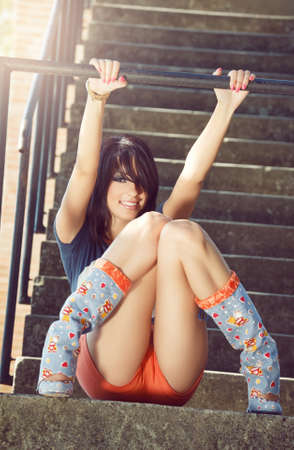 Fashion portrait of happy sexy young girl outdoor photo