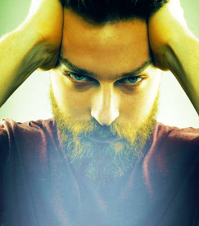 Face of handsome young man with hipster style beard photo