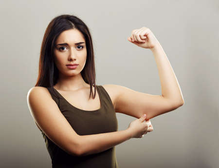 Young woman pinching arm fat flabby skin Stock Photo