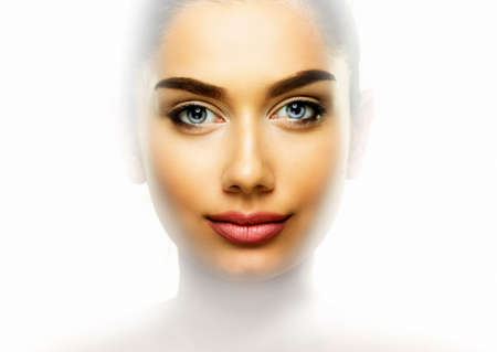 Beauty portrait of young woman with beautiful skin face over clean white Stock Photo