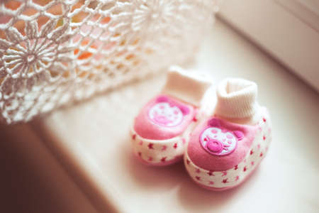 Pink baby shoes for newborn child