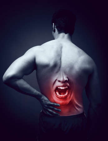 Man suffering back pain concept Stock Photo