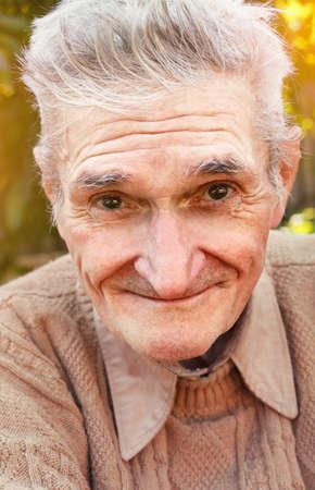 Portrait of happy senior man smiling Stock Photo