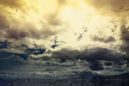 Global warming concept landscape. Dramatic cloudy sky and dry cracked earth Stock Photo