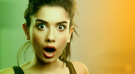 Face expression of shocked surprised young cute woman