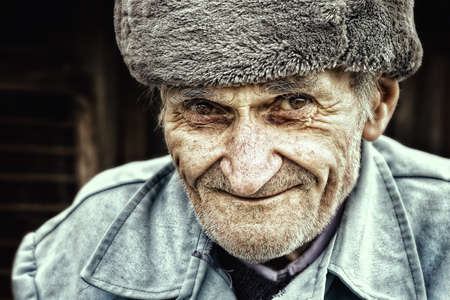Old senior man smiling for outdoor portrait. East european people