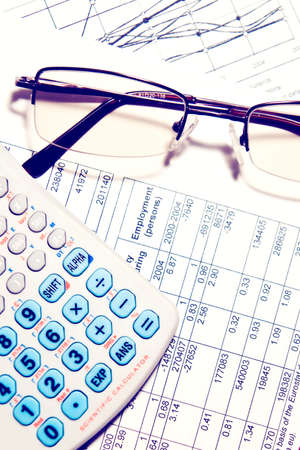 Business financial report chart with calculator and glasses. Tax, investment or banking concept Stock Photo