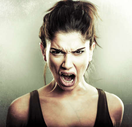 Face of angry mad furious young woman Stock Photo