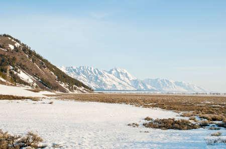 frigid: The Teton Mountain Range and sagebrush steppe of Wyoming near Jackson Hole in Spring.