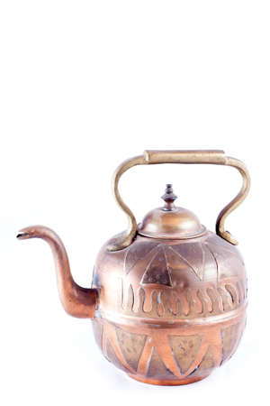 Ancient arabic ornamental teapot on white background Stock Photo
