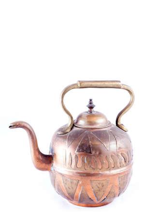 Ancient arabic ornamental teapot on white background Stock Photo